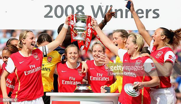 Faye White and Jayne Ludlow of Arsenal lead the trophy celebrations after victory in the The FA Womens Cup Sponsored by EON match between Arsenal and...