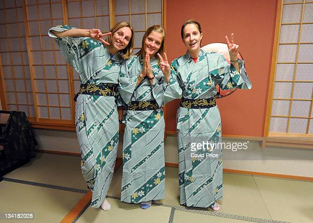 Faye White and Katie Chapman and Yvonne Tracy of Arsenal Ladies FC players in Kimono's in their hotel in Kyoto during their tour to Japan on November...