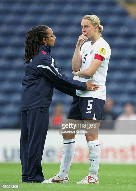 Faye White of England is consoled by coach Hope Powell after exiting the tournament by coach Hope Powell during UEFA Women's Europen Championship...