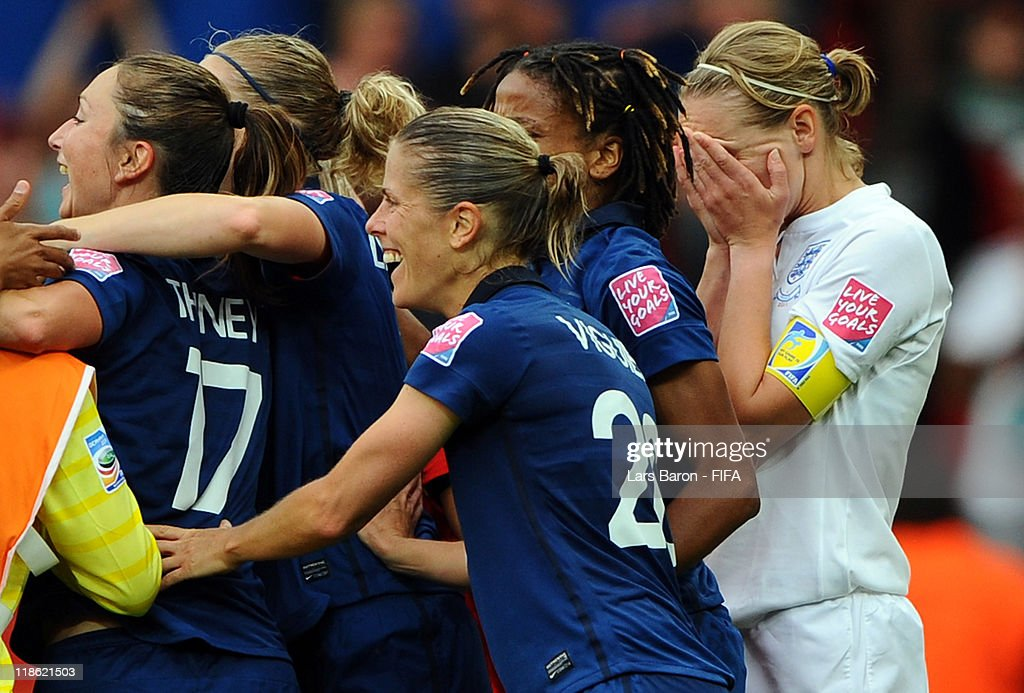 Faye White of England looks dejected next to the celebration of players of France after missing the last penalty and loosing the FIFA Women's World Cup 2011 Quarter Final match between England and France at the FIFA Women's World Cup Stadium Leverkusen on July 9, 2011 in Leverkusen, Germany.
