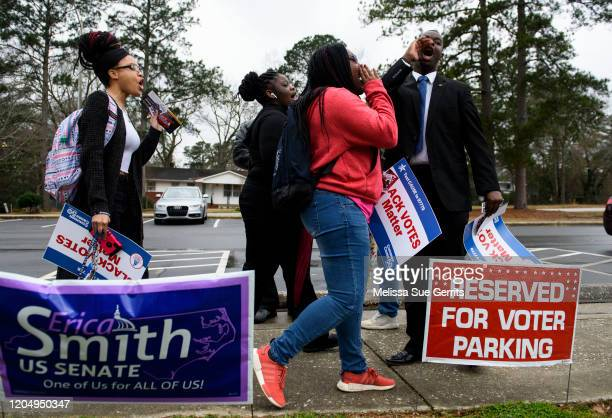 Fayetteville State University student NAACP chapter President Ty Hamer leads a call as students walk to Smith Recreation Center to vote on March 3...