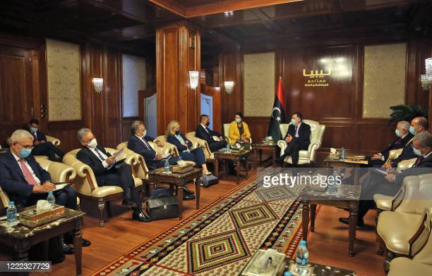 Fayez al-Sarraj , Prime Minister of Libya's UN-recognised Government of National Accord , meets with Italy's Foreign Minister Luigi Di Maio in the...