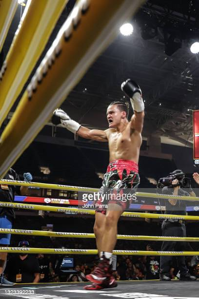 Faze Jarvis celebrates after his win during LivexLive's Social Gloves: Battle Of The Platforms PPV Livestream at Hard Rock Stadium on June 12, 2021...
