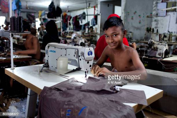 SADARGHAT DHAKA BANGLADESH Fazul sews a cloth in a local garment shop in Dhaka Bangladesh World Day Against Child Labor was observed on 12 June...