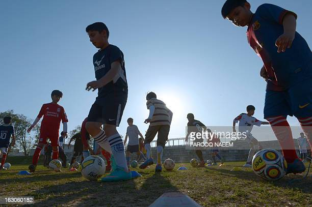 FblPAKAFCFOCUS by Damon Wake In this photograph taken on March 2 Pakistani children of the Islamabad Football Academy take part in a practice session...