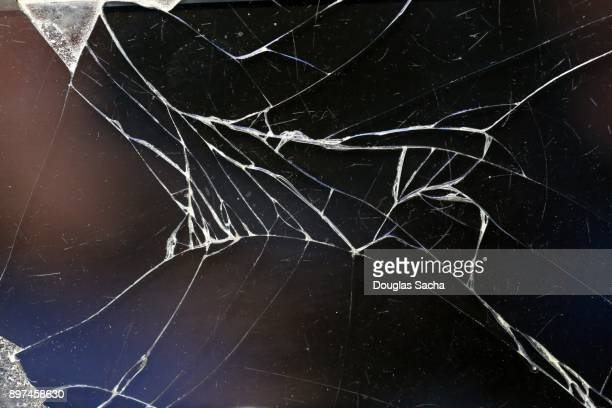 fbroken screen on a mobile device - shattered glass stock pictures, royalty-free photos & images