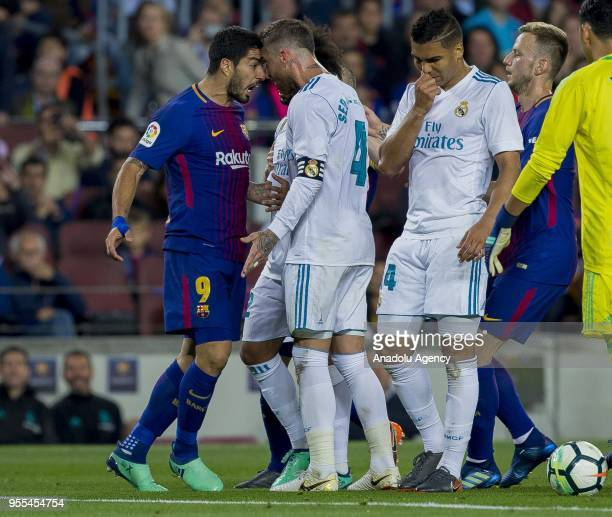 Fc Barcelona's Uruguayan forward Luis Suarez reacts against Real Madrid's spanish defender Sergio Ramos next to Casemiro and Marcelo during the...