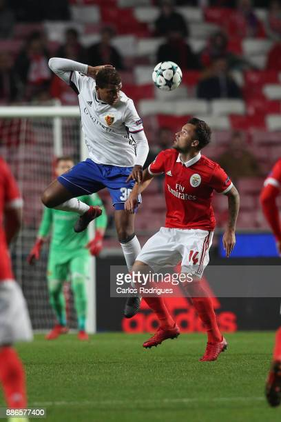 Fc Basel defender Manuel Akanji from Switzerland vies with Benfica's midfielder Andreas Samaris from Greece for the ball possession during SL Benfica...