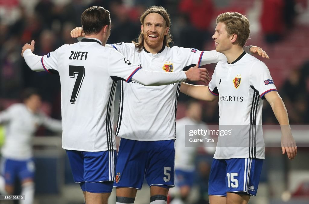 Fc Basel defender Michael Lang from Switzerland celebrates the victory with teammates Fc Basel midfielder Alexander Fransson from Sweden and Fc Basel midfielder Luca Zuffi from Switzerland at the end of the UEFA Champions League match between SL Benfica and FC Basel at Estadio da Luz on December 5, 2017 in Lisbon, Portugal.
