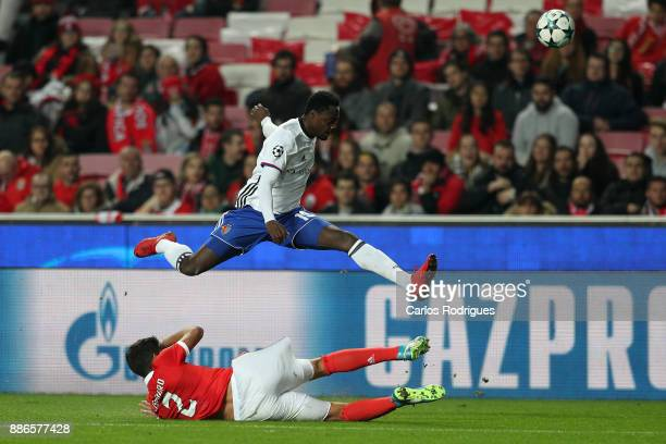 Fc Basel forward Dimitri Oberlin from Switzerland tries to escape Benfica's defender Lisandro Lopez from Argentina during SL Benfica v FC Basel UEFA...