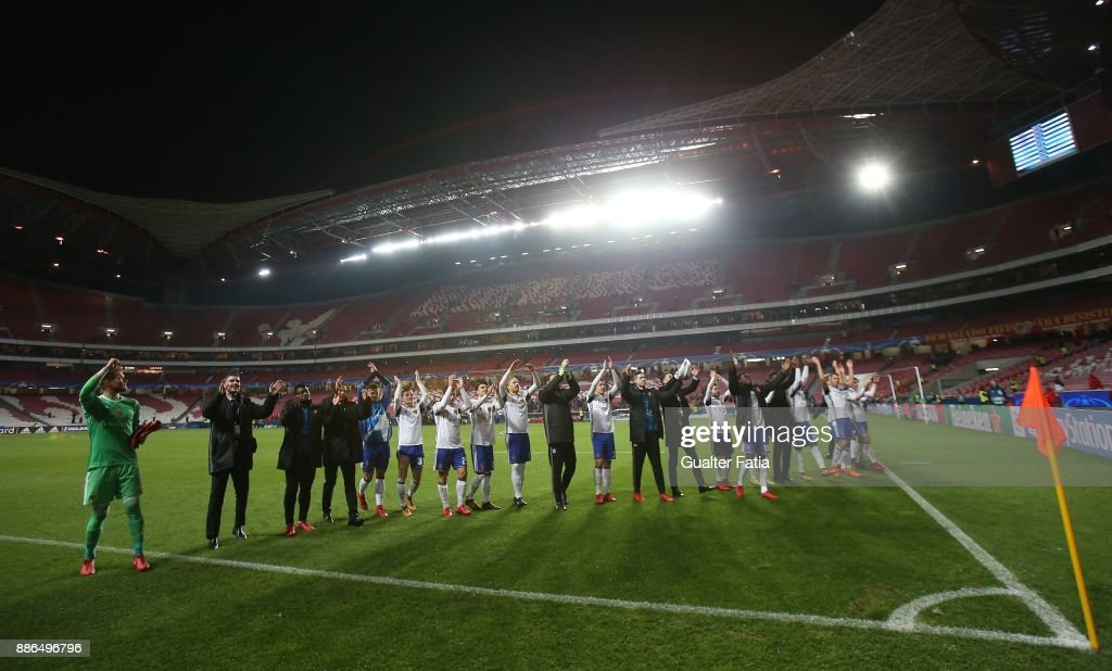 Fc Basel players and staff members celebrate the victory at the end of the UEFA Champions League match between SL Benfica and FC Basel at Estadio da Luz on December 5, 2017 in Lisbon, Portugal.