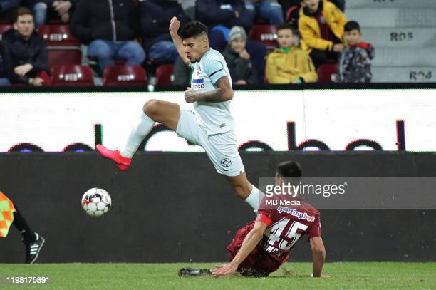FCSBs Florinel Coman tackled by CFR Cluj's captain Camora during the Liga I match between CFR Cluj and FCSB at DrConstantinRadulescuStadium on...