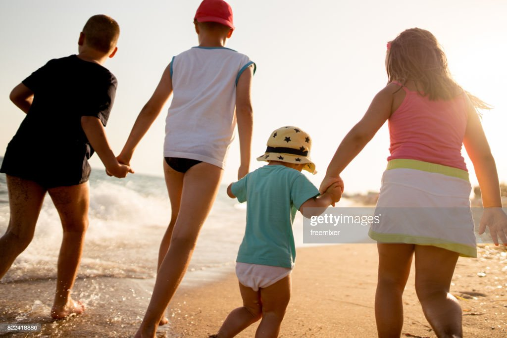 FDour kids going for a walk : Stock Photo