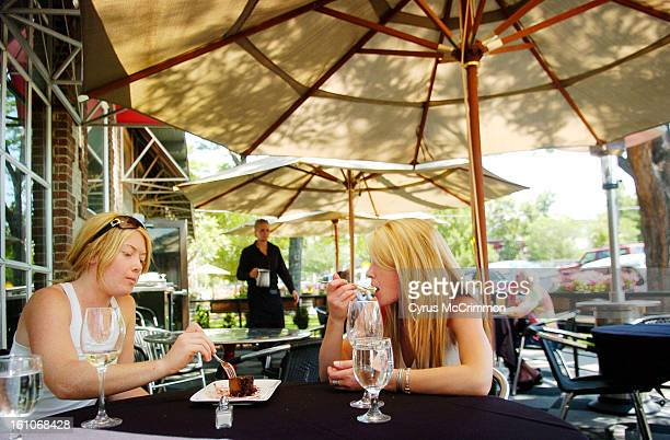 FE20FDDining_CM01 Sisters Sember <cq> Anderson and Kyra Anderson share a chocolate mousse desert during an outdoor lunch at Strings Restaurant at...