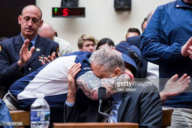 FealGood Foundation co-founder John Feal hugs former Daily Show Host Jon Stewart during a House Judiciary Committee hearing on reauthorization of the...