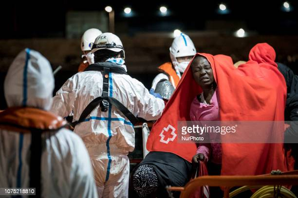 A feamle rescued migrant onboard the Spanish Maritime vessel on 22 December 2018 in Malaga Spain 120 migrants were recued from the danger of crossing...