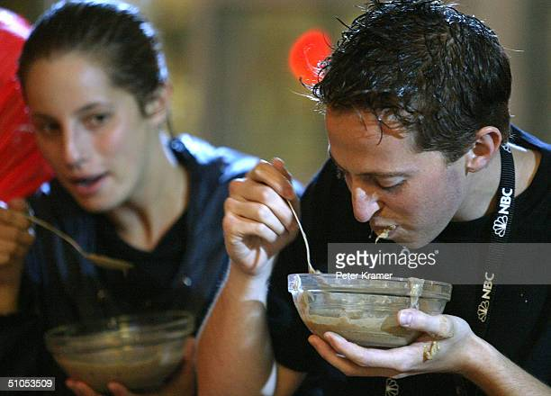 Fear Factor employee Josh Silverman does a taste test of blended rat for the second stunt in Times Square to celebrate the show's 100th episode July...