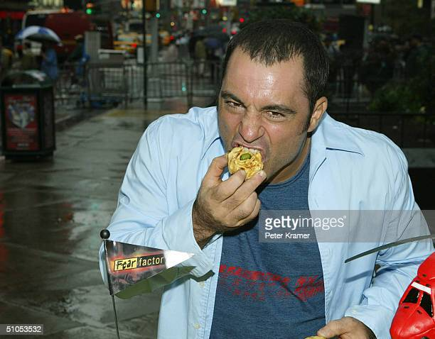 Fear Factor host Joe Rogan makes an appearance in Times Square to celebrate the show's 100th episode July 12, 2004 in New York City.
