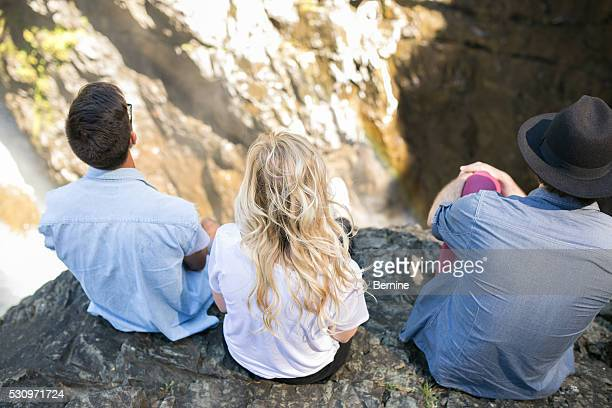 Fear High View of Young Adults Overlooking Cliff and Waterfall