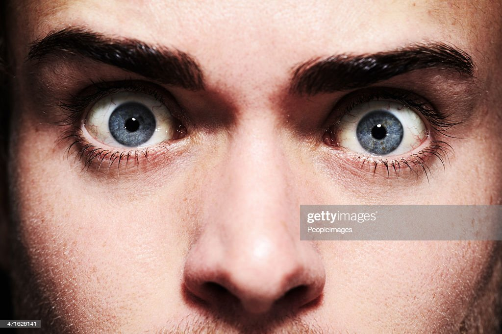 Fear in his eyes : Stock Photo