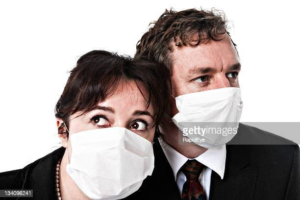 fear of contagion: masked business couple - hypochondria stock photos and pictures