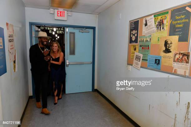 'Fear The Walking Dead' television series cast members Colman Domingo and Kim Dickens enter the Fear the Walking Dead Survival attraction during its...