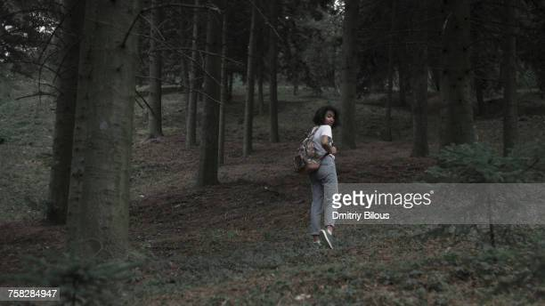 Fearful woman running in woods
