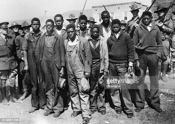 Fearing a mob lynching Alabama Governor BM Miller called the National Guard to the Scottsboro jail to protect the young black men who are accused of...