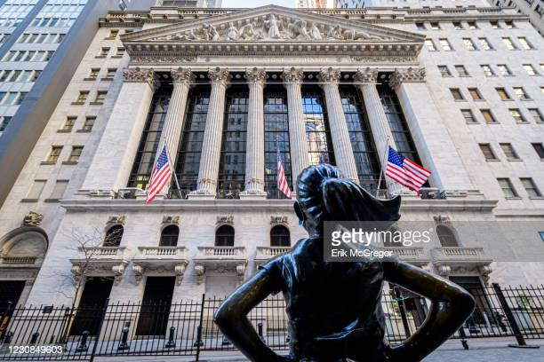 Fearless Girl statue across the New York Stock Exchange in Wall Street.