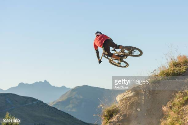 Fearless man jumping in midair with dirt bike