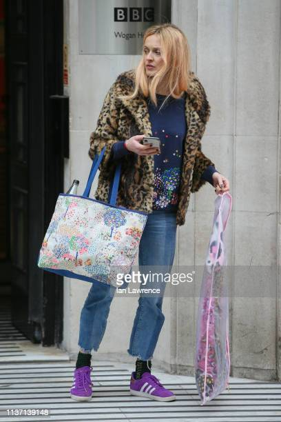 Fearne Cotton carrying a Vivienne Westwood clothes bag as she leaves BBC Radio Two Studios on a Motorbike Taxi on March 20 2019 in London England