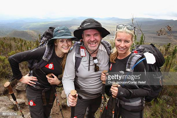 Fearne Cotton Chris Moyles and Denise Van Outen pose for a photograph as they trek up Kilimanjaro on the second day of The BT Red Nose Climb of...