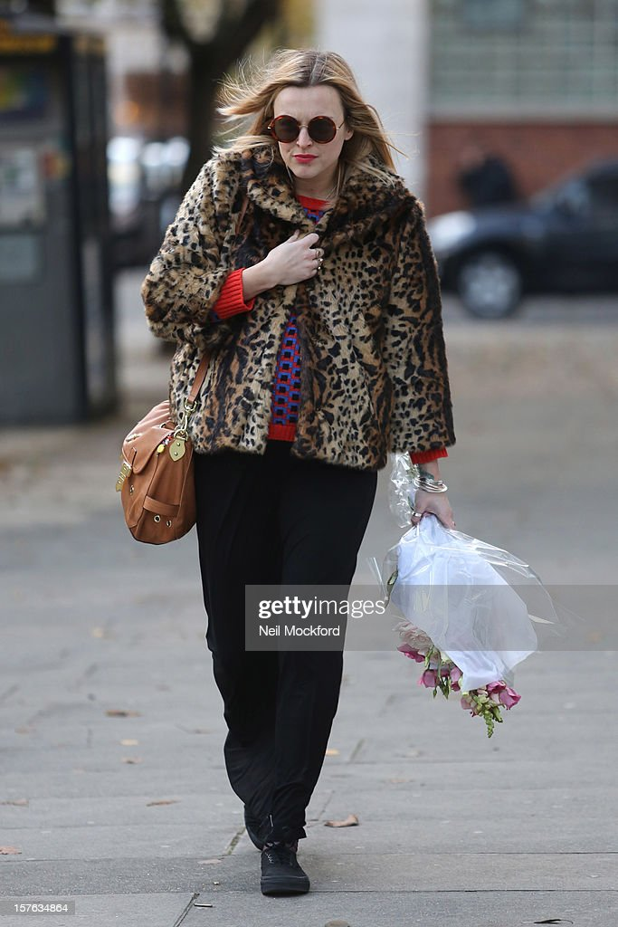 Fearne Cotton is pictured with flowers on her last day at Radio 1 before her maternity leave starts on December 5, 2012 in London, England.