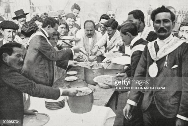 Feast of St Francis for the poor in Posillipo pots of macaroni Italy photograph by Charles Abeniacar from L'Illustrazione Italiana Year XXXII No 47...