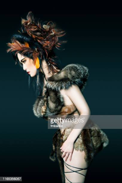 feather and fur asian avant garde - female hairy arms stock photos and pictures
