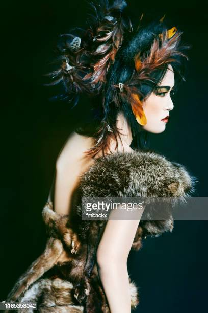 feather and fur asian beauty back view - female hairy arms stock photos and pictures