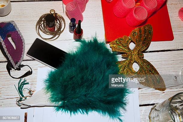 Feather fan, party mask, hair rollers, nail varnish, smartphone