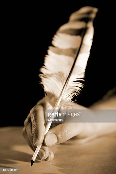 Feather pen in a hand (sepia)