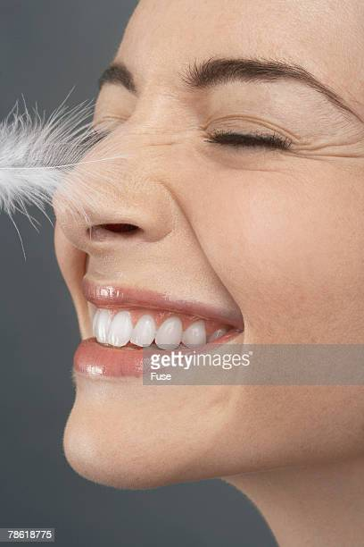 Feather Tickling Woman's Nose