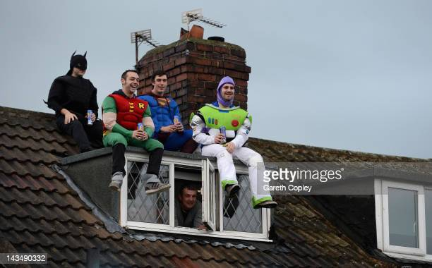 Featherstone Rovers fans in costume watch during the Carnegie Challenge Cup 5th round match between Featherstone Rovers and Wigan Warriors at Post...