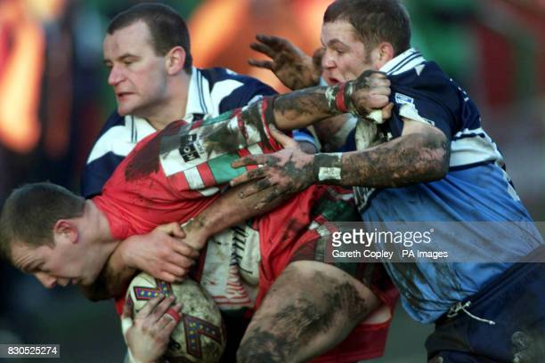 Featherstone Rovers' Nick Simpson and Danny Evans tackle Keighley Cougars' Darren Carter during the Northern Ford Premiership game at Cougar Park...