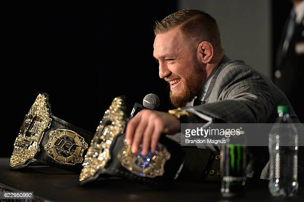 Featherweight and lightweight champion Conor McGregor of Ireland speaks to the media during the UFC 205 post fight press conference at Madison Square...