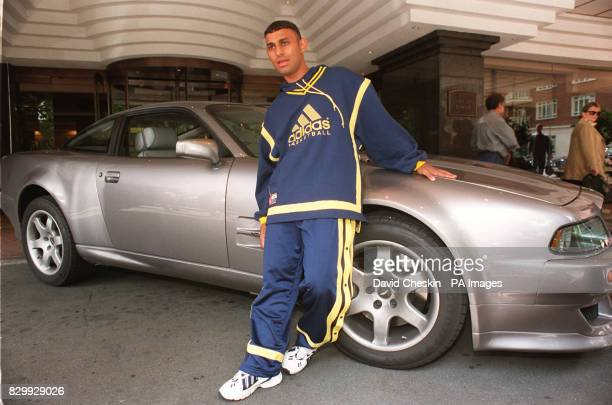 Featherweight boxer Prince Naseem Hamed stands next to his scratched, Aston Martin 'Vantage' at the Hyatt Carlton Tower Hotel in London today where...