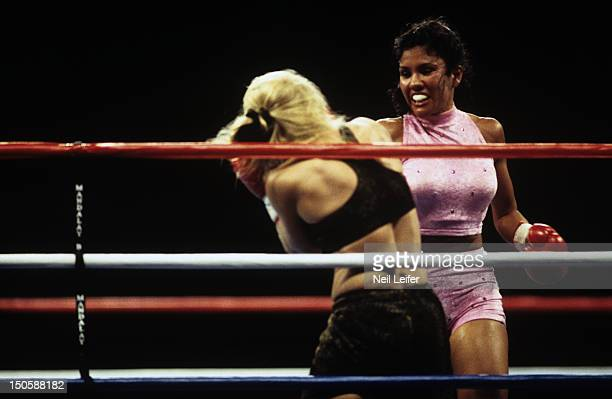 Mia St John in action vs Kelly Downey during fight at Mandalay Bay Events Center Las Vegas NV CREDIT Neil Leifer
