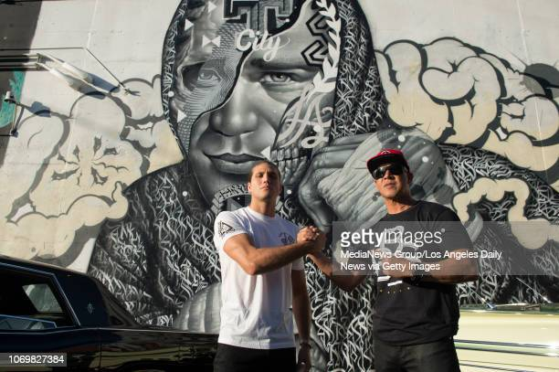 UFC featherweight Brian Ortegrtega and coach James Luhrsen in front of a mural of Ortega created by artists Tristan Eaton Richard Wyrgatsch II and...