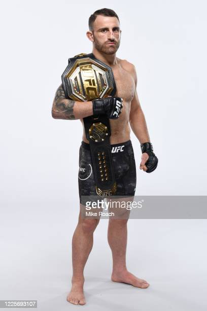 Featherweight Champion Alexander Volkanovski of Australia poses for a portrait during a UFC photo session on July 7, 2020 in Yas Island, Abu Dhabi,...