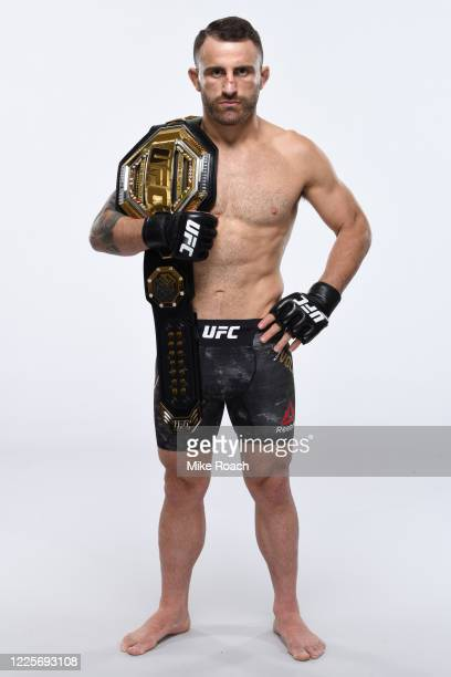 Featherweight Champion Alexander Volkanovski of Australia poses for a portrait during a UFC photo session on July 7 2020 in Yas Island Abu Dhabi...