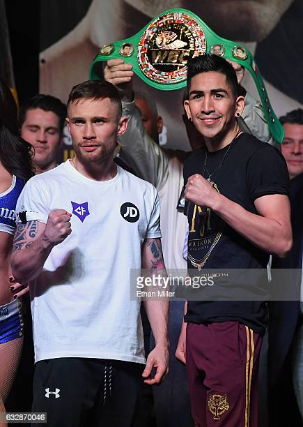 WBA featherweight champion Carl Frampton and Leo Santa Cruz pose during their official weighin at MGM Grand Garden Arena on January 27 2017 in Las...