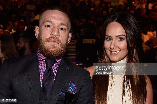 UFC featherweight champion Conor McGregor and girlfriend Dee Devlin in attendance during the UFC 200 event on July 9 2016 at TMobile Arena in Las...