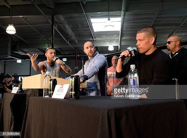 UFC featherweight champion Conor McGregor and lightweight contender Nate Diaz participate in a news conference with moderator Dave Sholler UFC vice...